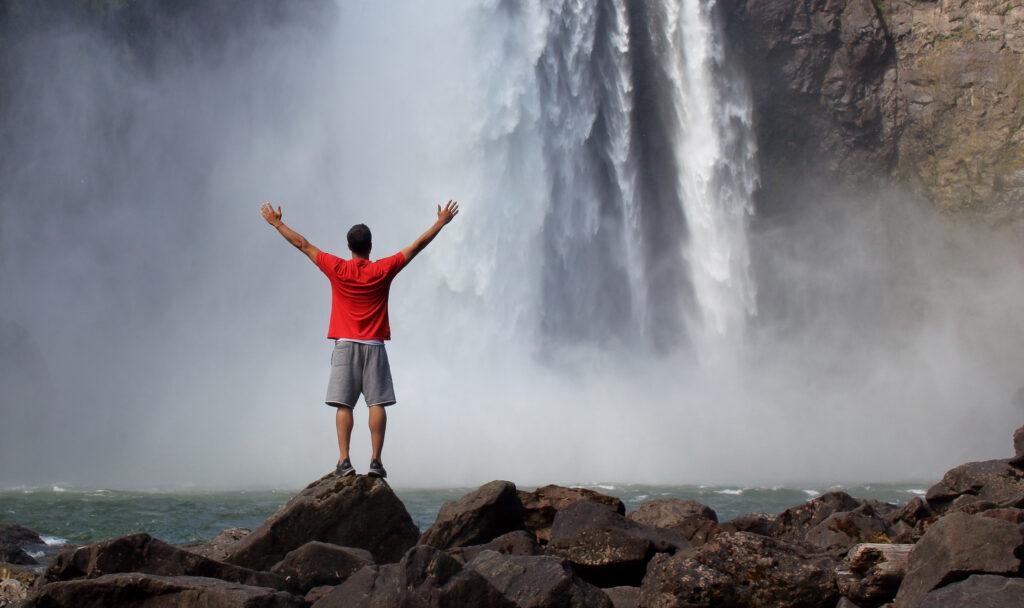 Man in waterfall hiking in Seattle